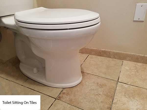 replace broken toilet after
